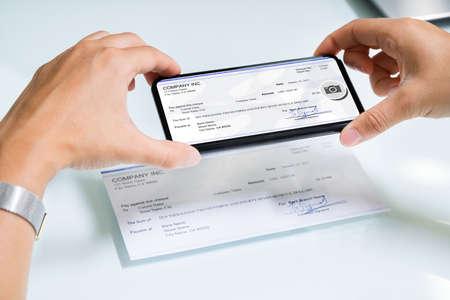 Scanning Remote Deposit Check Document Using Phone. Taking Photo Reklamní fotografie