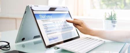 Online Survey Form On Laptop Screen Close Up