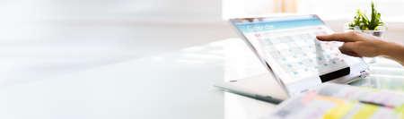 Online Calendar Business Planner On Convertible Laptop