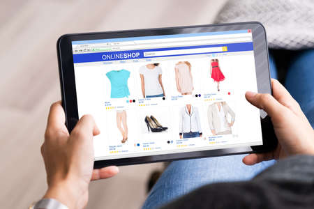 Online Shopping Searching Clothes On Tablet In Internet Store