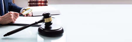 Attorney Working In Court On Law Contract Document With Gavel