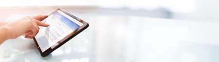 Filling Online Survey Form Or Questionnaire Poll On Tablet Standard-Bild