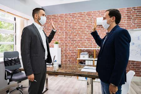 Man Avoiding Handshake To Stop Covid-19 Spread Waving Hands