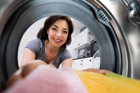 Woman Using Washing Machine Appliance Or Cloth Dryer Standard-Bild