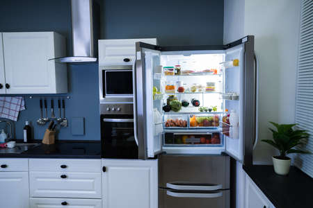 Open Refrigerator Or Fridge At Home In Kitchen