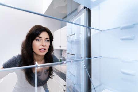 Looking In Empty Refrigerator Or Fridge With Open Door Standard-Bild