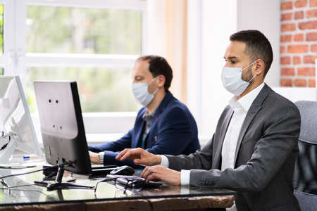 Customer Service Support Agents In Headsets And Face Masks Standard-Bild