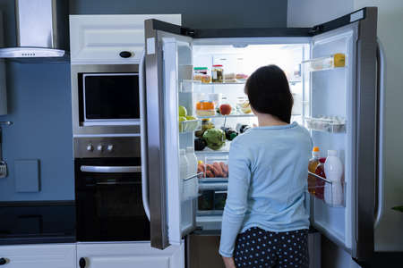 Hungry Woman At Night With Open Fridge