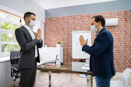 Man Avoiding Handshake To Stop Covid-19 Spread Doing Namaste Gesture Standard-Bild