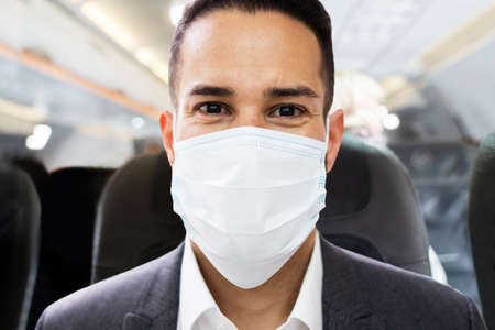 Man In Face Mask Traveling On Plane Or Airplane