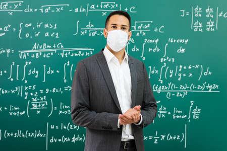 University Professor Standing In Class Wearing Face Mask Zdjęcie Seryjne