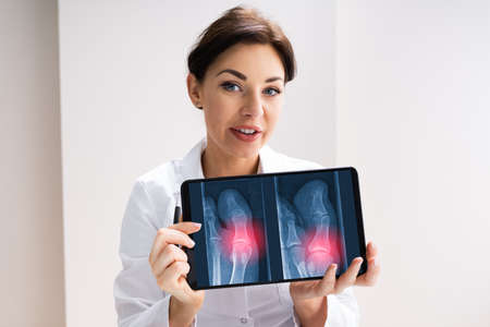 Female Doctor Holding Xray Scan Image In Hospital