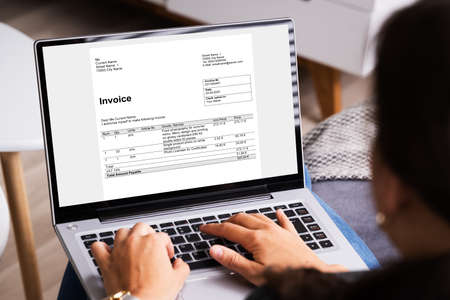 Online Invoice Management. Young Accountant Doing Audit