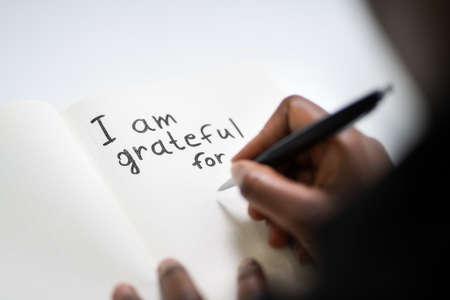 African American Women Writing In Gratitude Journal