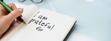 Gratitude Journal Concept. Writing I Am Grateful In Journal Stock fotó