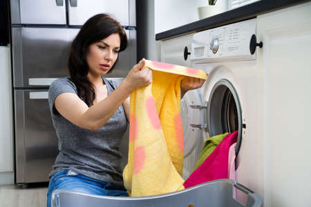 Stained Pink Clothes In Washing Machine. Laundry Cleaning