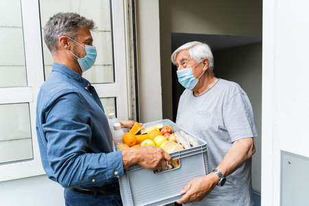Doctor Talking To Elderly Patient At Home