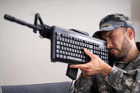 Social Cyber Warfare. Army Soldier Using Computer Keyboard