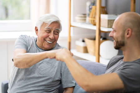 Happy Grandpa Making Fist Bump With His Grandson