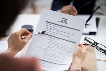 Reading Resume And Recruitment Application At Job Interview
