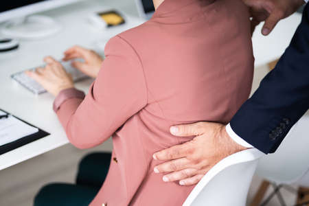 Sexual Harassment At Workplace. Touching Woman At Work Archivio Fotografico
