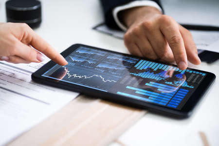 Financial Analyst And Business Advisor Accounting Review On Tablet Archivio Fotografico