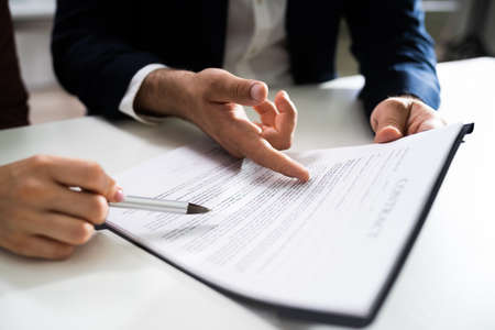Lawyer People Review Document Before Signing In Office