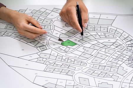 Cadastre Land Map. Cartographer Locating Building Plot Foto de archivo