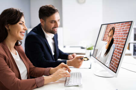 Online Video Conference Meeting On Computer In Office