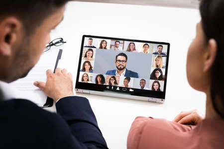 Online Video Conference Meeting On Tablet In Office