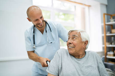 Senior Healthcare Caregiver And Happy Elder Patient Stock Photo
