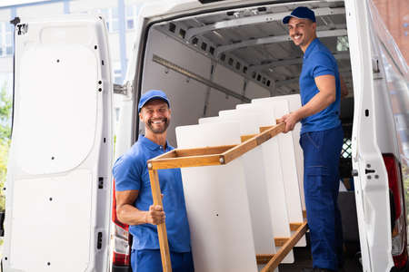 Furniture Move And Delivery Service. House Removal Stock Photo