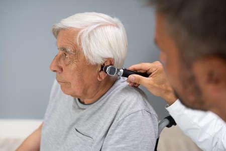 Otolaryngology Check. Doctor Checking Ear Using Otoscope