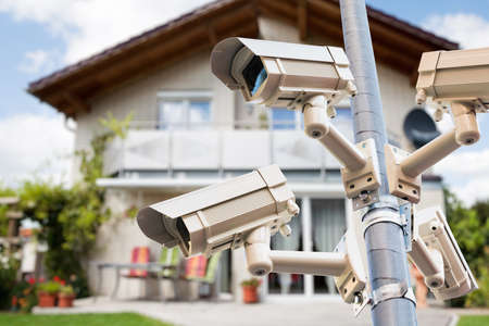 CCTV Security Video Cameras Watching Private House