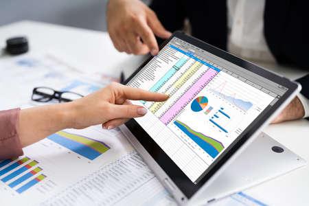 Analyst Employee Working On Spreadsheet Using Laptop