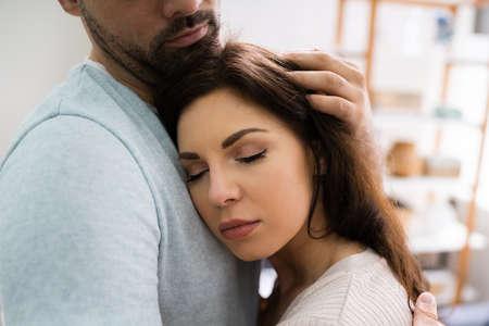 Man Boyfriend Hugging Depressed Woman Girlfriend In Relationship