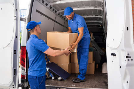 Home Moving Services. Movers Loading Van Or Truck