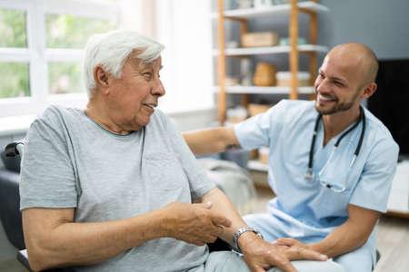 Senior Healthcare Caregiver And Happy Elder Patient