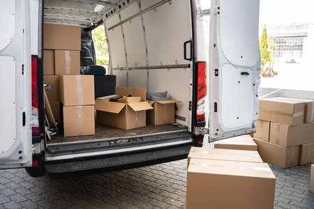 Van With Boxes On Street From Relocation Service Business Stockfoto