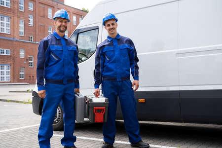 Repairman Electrician Man Or Repair Technicians Near Van Car