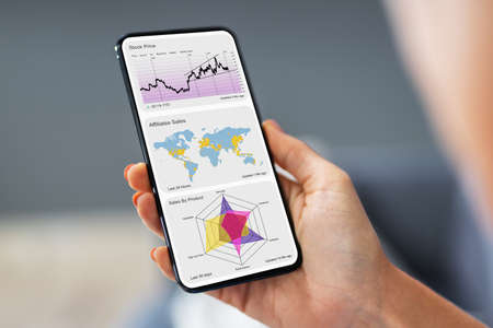 Mobile Phone And Smartphone Analytics Graph KPI Foto de archivo