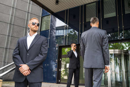 Security Guard Service Protecting Business Man Outside