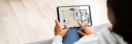 Buying House Online On Tablet Computer. Home Management Imagens