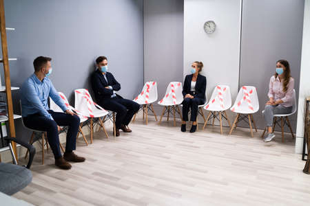 Diverse Job Applicants Waiting For Interview In Face Masks