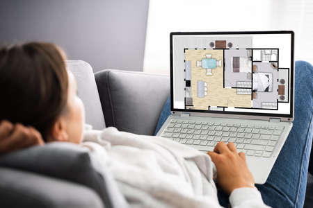 Buying House Online On Laptop. Home Management Imagens