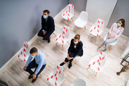 Diverse Job Applicants Waiting For Interview In Face Masks Stock Photo