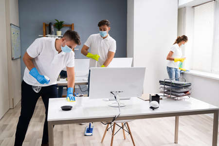 Professional Office Cleaning Services With Face Masks Reklamní fotografie