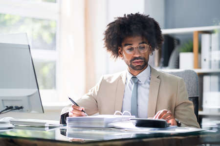 African American Accountant Manager Doing Tax Accounting Stock Photo
