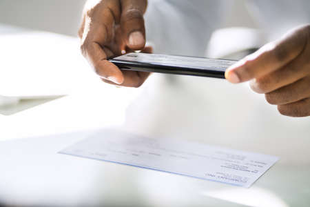 Remote Check Deposit Using Mobile Photo Scanning Stock Photo