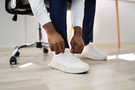 African American Man Changing To Running Sports Shoes